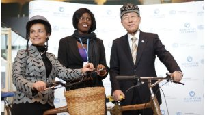 Taking bamboo bicycles for a spin around the Warsaw Climate Change Conference with UN Secretary-General Ban Ki-moon and Evelyn Ohenewaa Gyasi of the Ghana Bamboo Bikes Initiative